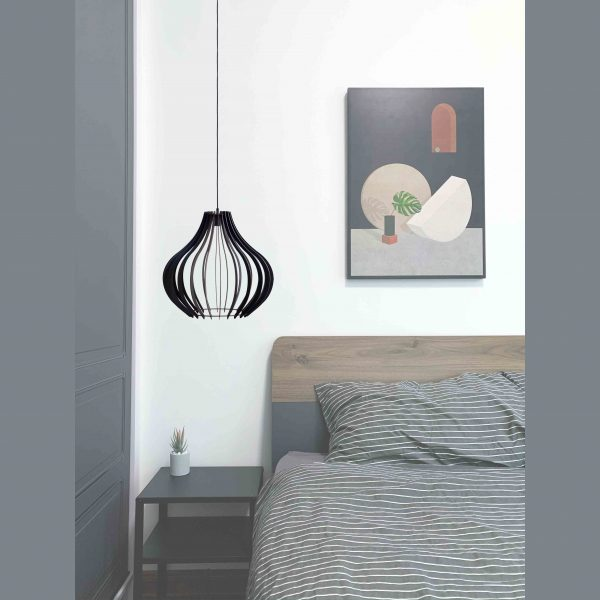 The Claremont pendant light situated as a bedside lamp