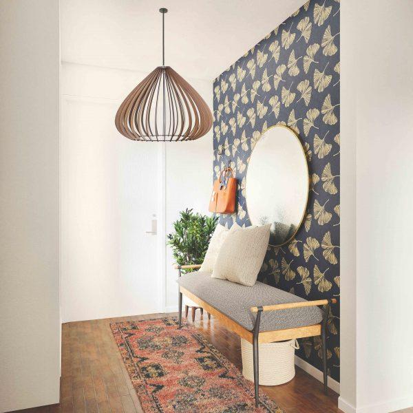 The Merlot pendant light hanging in hallway with wallpaper