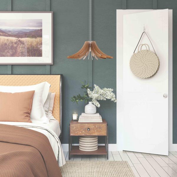 The Dahlia wooden pendant light as a bedside light in pretty bedroom decor