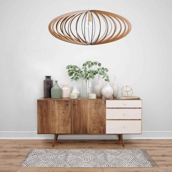 The Pinot wooden pendant light hung above a pretty sideboard