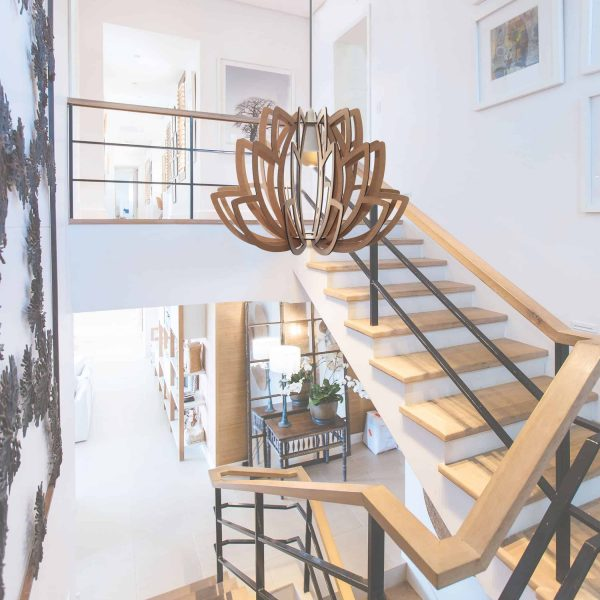 Large Lotus pendant hanging in a stairwell