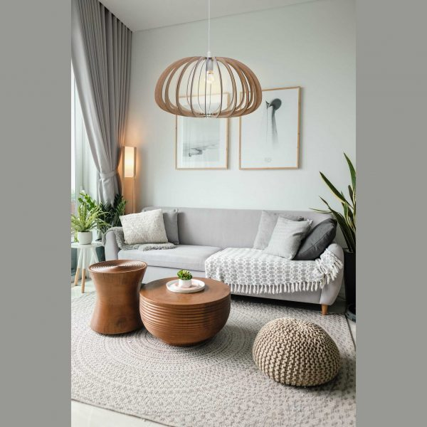 The Aquarius style wooden pendant light styled in a pretty lounge