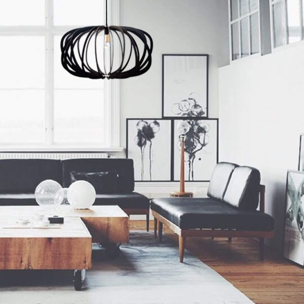 The Libra style wooden pendant light in black shown in monochrome decor situation