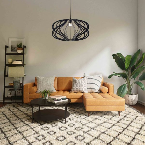 The Virgo pendant light in black in a lounge with orange couch
