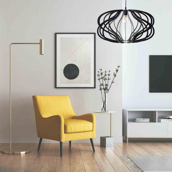The Virgo pendant light in black in a sitting area with yellow chair